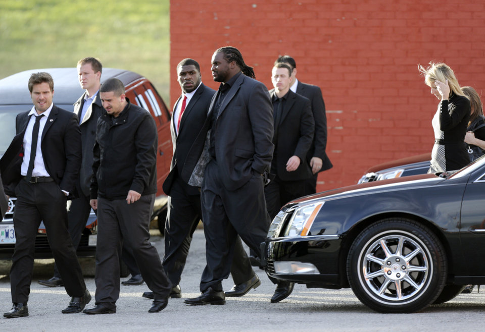 Photo - Kansas City Chiefs players and friends leave a memorial service for Jovan Belcher at the Landmark International Deliverance and Worship Center, Wednesday, Dec. 5, 2012, in Kansas City, Mo. Belcher shot his girlfriend, Kasandra Perkins, at their home Saturday morning before driving to Arrowhead Stadium and turning the gun on himself. (AP Photo/Ed Zurga)
