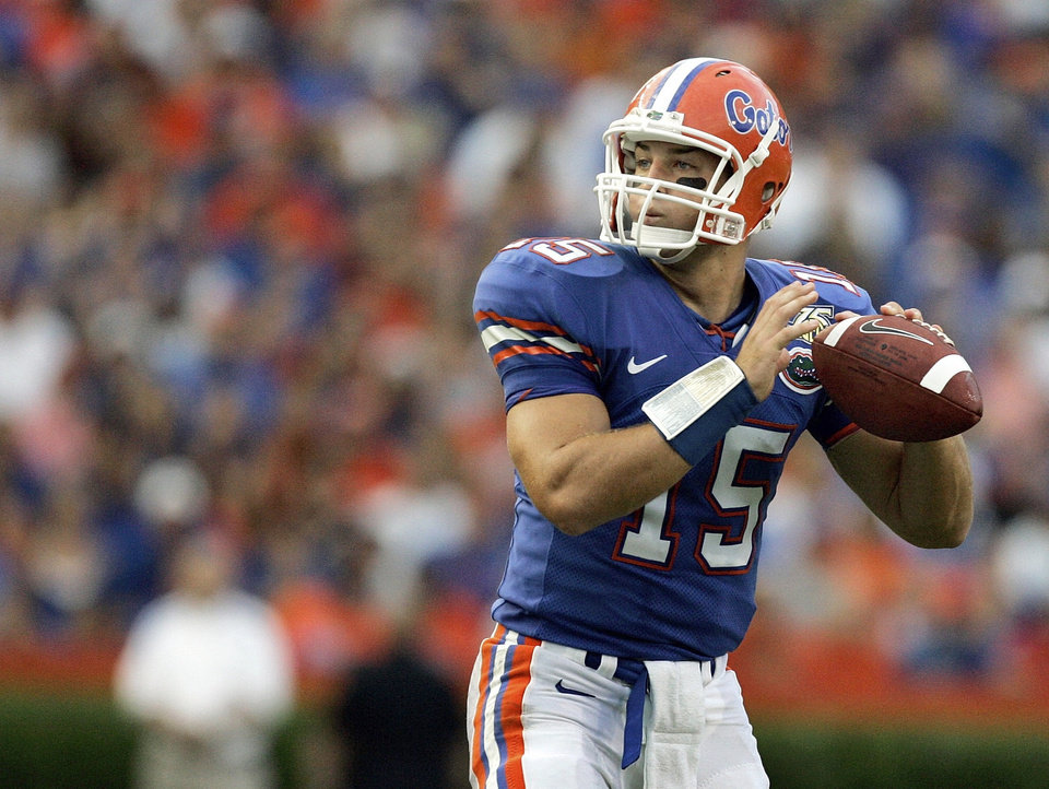 Photo - UNIVERSITY OF FLORIDA: Florida quarterback Tim Tebow looks for a receiver during the first half of a college football game against Troy in Gainesville, Fla., Saturday, Sept. 8, 2007. (AP Photo/John Raoux) ORG XMIT: NY162