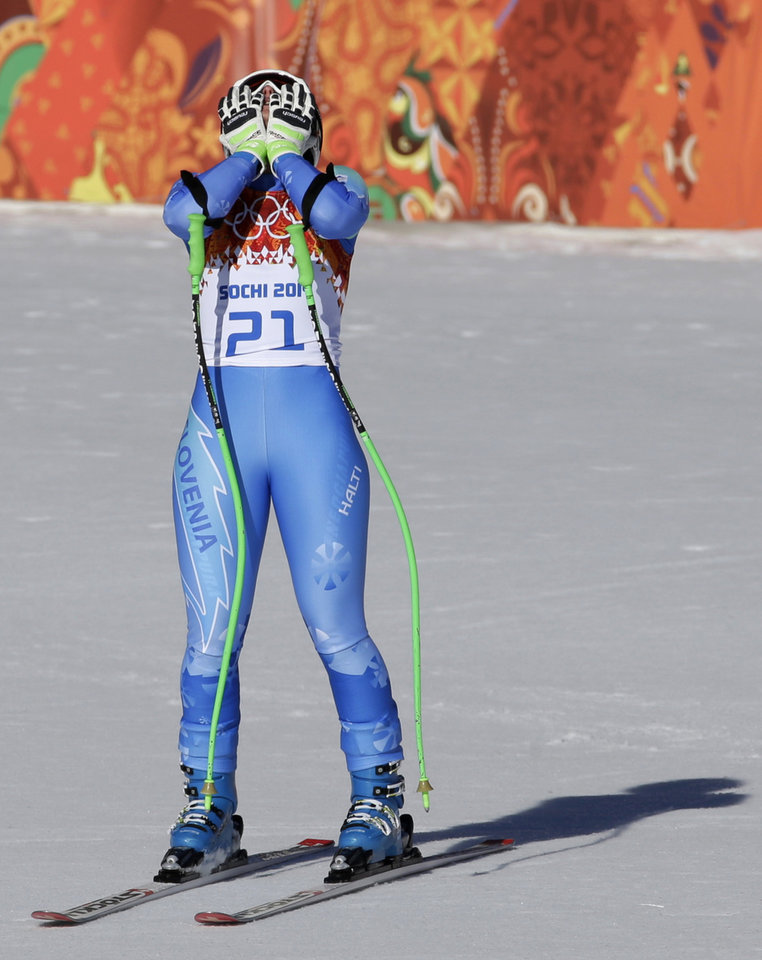 Photo - Slovenia's Tina Maze celebrates finishing the women's downhill, tying for first place with Switzerland's Dominique Gisin at the Sochi 2014 Winter Olympics, Wednesday, Feb. 12, 2014, in Krasnaya Polyana, Russia. (AP Photo/Gero Breloer)