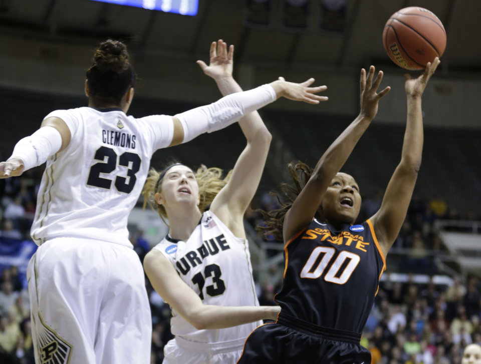 Oklahoma State guard Roshunda Johnson, right, shoots under Purdue forward Liza Clemons (23) and Purdue guard Bridget Perry during the first half of a women's second round NCAA tournament college basketball game in West Lafayette, Ind., Monday, March 24, 2014.  (AP Photo/Michael Conroy)
