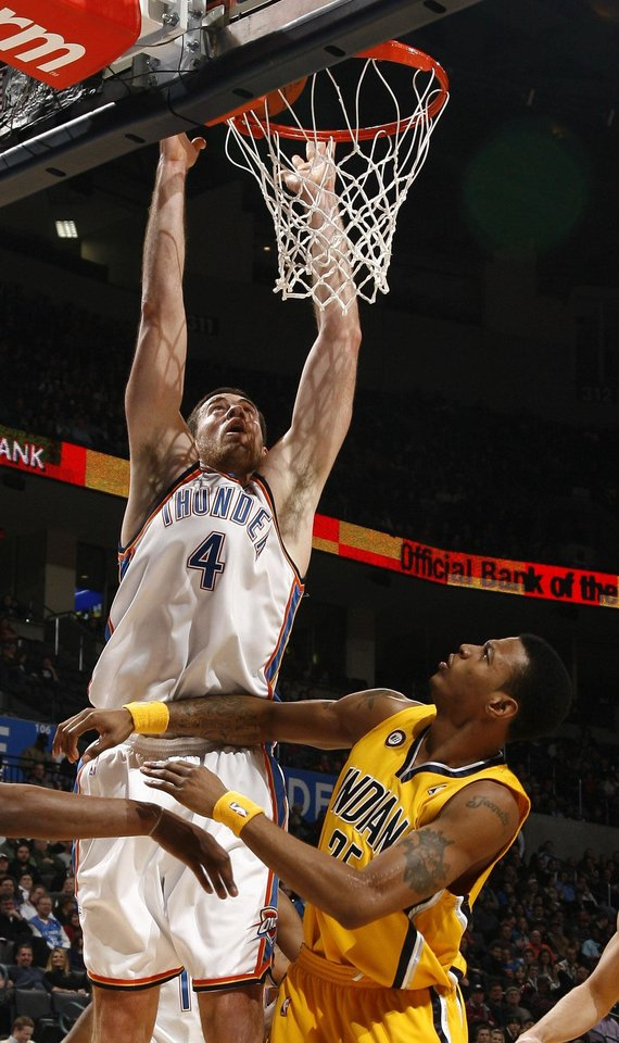 Oklahoma City's Nick Collison (4) shoots over Indiana's Brandon Rush (25) during the basketball game between the Oklahoma City Thunder and the Indiana Pacers, Saturday, Jan. 9, 2010 at the Ford Center in Oklahoma CIty. Photo by Sarah Phipps, The Oklahoman