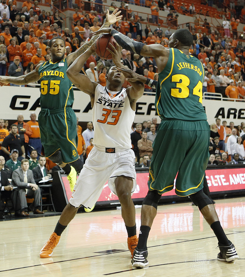 Baylor\'s Pierre Jackson (55) and Cory Jefferson (34) defend on Oklahoma State \'s Marcus Smart (33) during the college basketball game between the Oklahoma State University Cowboys (OSU) and the Baylor University Bears (BU) at Gallagher-Iba Arena on Wednesday, Feb. 5, 2013, in Stillwater, Okla. Photo by Chris Landsberger, The Oklahoman