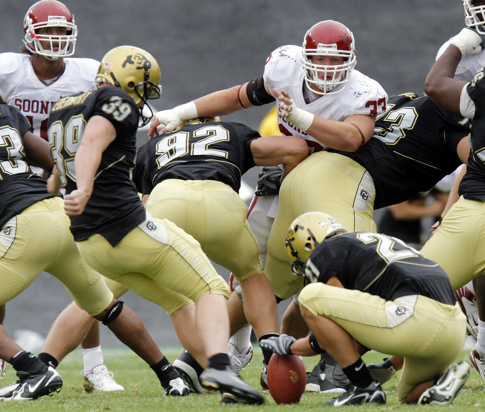 Photo - Colorado's Kevin Eberhart (39) kicks the game-winning field goal as time expires in the college football game between the University of Oklahoma Sooners (OU) and the University of Colorado Buffaloes (CU) at Folsom Field in Boulder, Co., on Saturday, Sept. 28, 2007. Colorado won, 27-24. By NATE BILLINGS, The Oklahoman