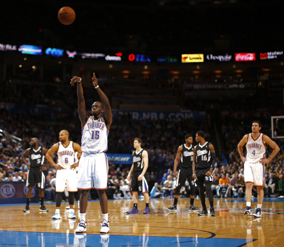 Photo - Oklahoma City's Reggie Jackson (15) shoots a free throw after a Sacramento technical foul during the NBA game between the Oklahoma City Thunder and the Sacramento Kings at the Chesapeake Energy Arena, Sunday, Jan. 19, 2014.  Photo by Sarah Phipps, The Oklahoman