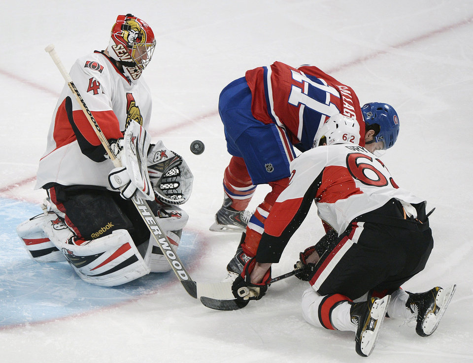 Photo - Ottawa Senators goaltender Craig Anderson, left, and Eric Gryba, right, defend as Montreal Canadiens' Brendan Gallagher moves in on net during the first period of an NHL hockey game in Montreal, Saturday, Jan. 4, 2014. (AP Photo/The Canadian Press, Graham Hughes)