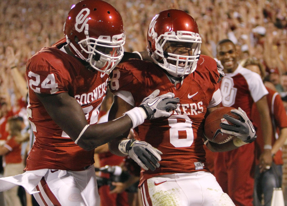 Oklahoma's Dejuan Miller (24) and Dominique Whaley (8) celebrate after Whaley's touchdown during the college football game between the University of Oklahoma Sooners (OU) and the University of Missouri Tigers (MU) at the Gaylord Family-Memorial Stadium on Saturday, Sept. 24, 2011, in Norman, Okla. Photo by Chris Landsberger, The Oklahoman