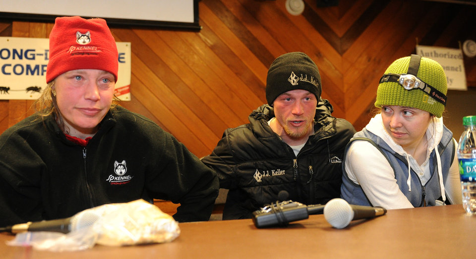Photo - Second placed Aliy Zirkle, left, site beside winner Dallas Seavey and his wife, Jen, at the Iditarod headquarters, after finishing the 2014 Iditarod Trail Sled Dog Race in Nome, Alaska, Tuesday, March 11, 2014.  (AP Photo/The Anchorage Daily News, Bob Hallinen)  LOCAL TV OUT (KTUU-TV, KTVA-TV) LOCAL PRINT OUT (THE ANCHORAGE PRESS, THE ALASKA DISPATCH)