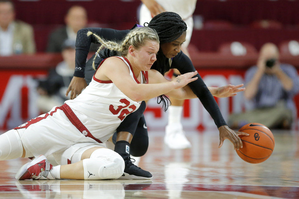 Photo - Oklahoma's Tatum Veitenheimer (32) dives for the ball beside Central Arkansas' Kamry Orr (2) during an NCAA women's basketball game between the University of Oklahoma (OU) and Central Arkansas at Loyd Noble Center in Norman, Okla., Wednesday, Dec. 5, 2018. Photo by Bryan Terry, The Oklahoman