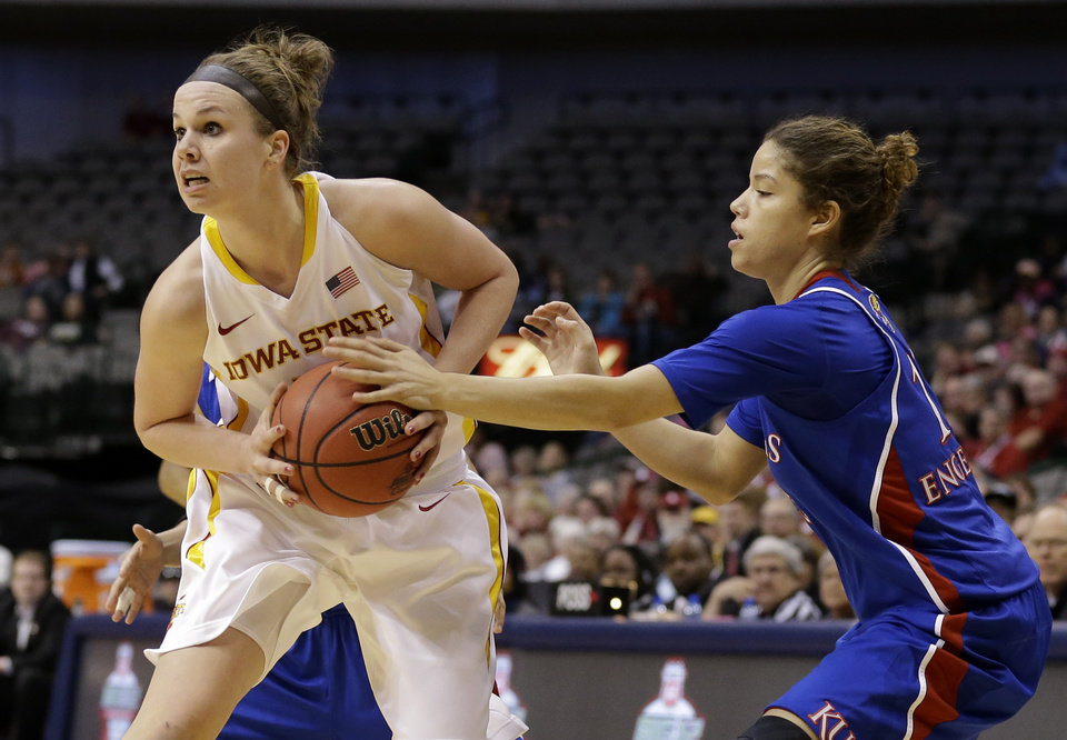 Photo - Iowa State' Hallie Christofferson (5) gets by Kansas' Monica Engelman, right, on a drive to the basket in the first half of an NCAA college basketball game in the Big 12 Conference women's tournament Saturday, March 9, 2013, in Dallas. (AP Photo/Tony Gutierrez)
