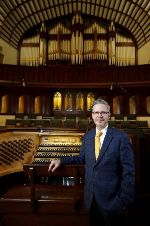 Photo -  Steven McConnell, music minister and organist at First Baptist Church of Oklahoma City, stands in front of the church's historic pipe organ, which will be the center of attention at a Nov. 1 organ recital commemorating the churc's 130th anniversary. [Bryan Terry/The Oklahoman]