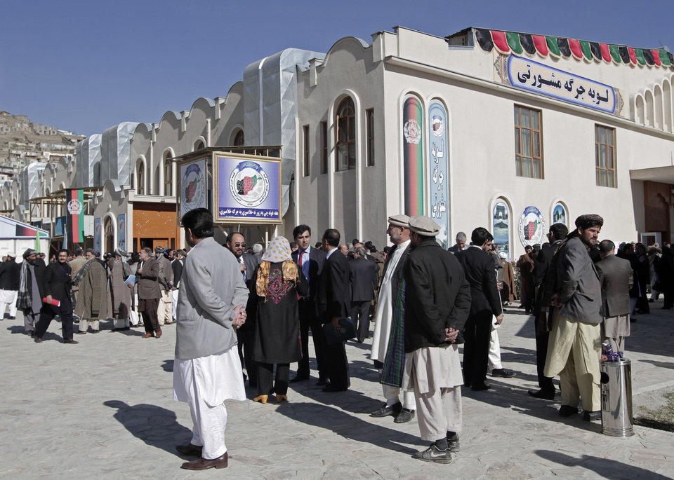 Photo - Members of the Afghan Loya Jirga gather outside the venue where the Loya Jirga is taking place in Kabul, Afghanistan, Thursday, Nov. 21, 2013. Afghan President Hamid Karzai has told a gathering of elders that he supports signing a security deal with the United States if safety and security conditions are met. Karzai spoke as the 2,500-member national consultative council of Afghan elders known as the Loya Jirga started in Kabul on Thursday. The four-day meeting will discuss the bilateral security pact that defines the role of thousands of U.S. troops who will remain after the NATO combat mission ends in 2014. (AP Photo/Rahmat Gul)
