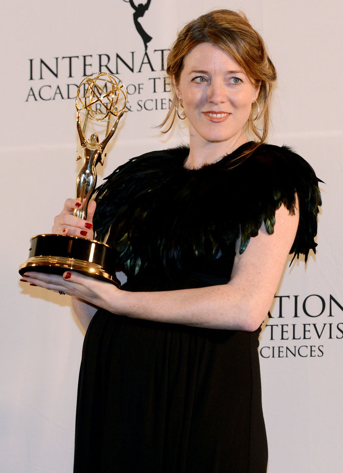 Photo -   Annabel Jones of Great Britain holds her emmy after winning the TV Movie/Mini-Series award for