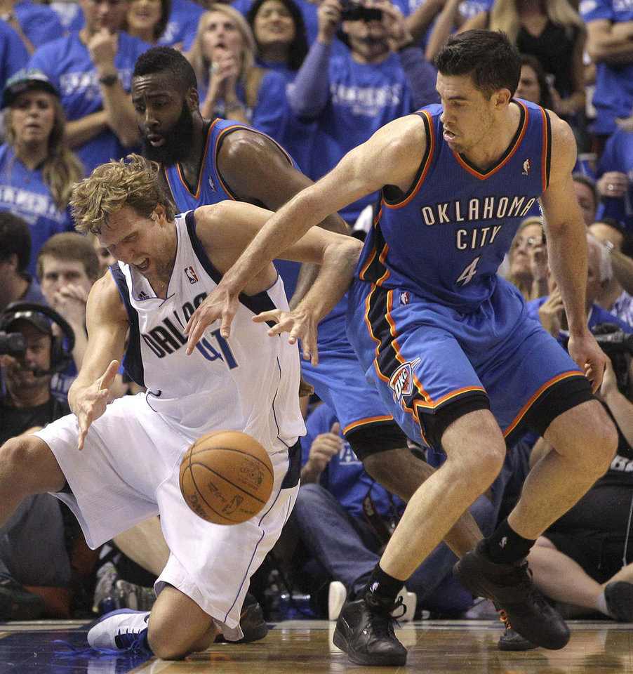 Photo -   Dallas Mavericks power forward Dirk Nowitzki (41) of Germany loses control of the ball against Oklahoma City Thunder Nick Collison (4) and James Hardin in the fourth quarter of Game 4 in a first-round NBA basketball playoff series, Saturday, May 5, 2012, in Dallas. The Thunder won 103-97. (AP Photo/LM Otero)