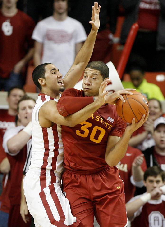 Oklahoma's C.J. Washington (5) defends Iowa State's Royce White (30) during an NCAA basketball game between the University of Oklahoma Sooners (OU) and the Iowa State Cyclones (ISU) at the Lloyd Noble Center in Norman, Saturday, Feb. 4, 2012. Photo by Bryan Terry, The Oklahoman