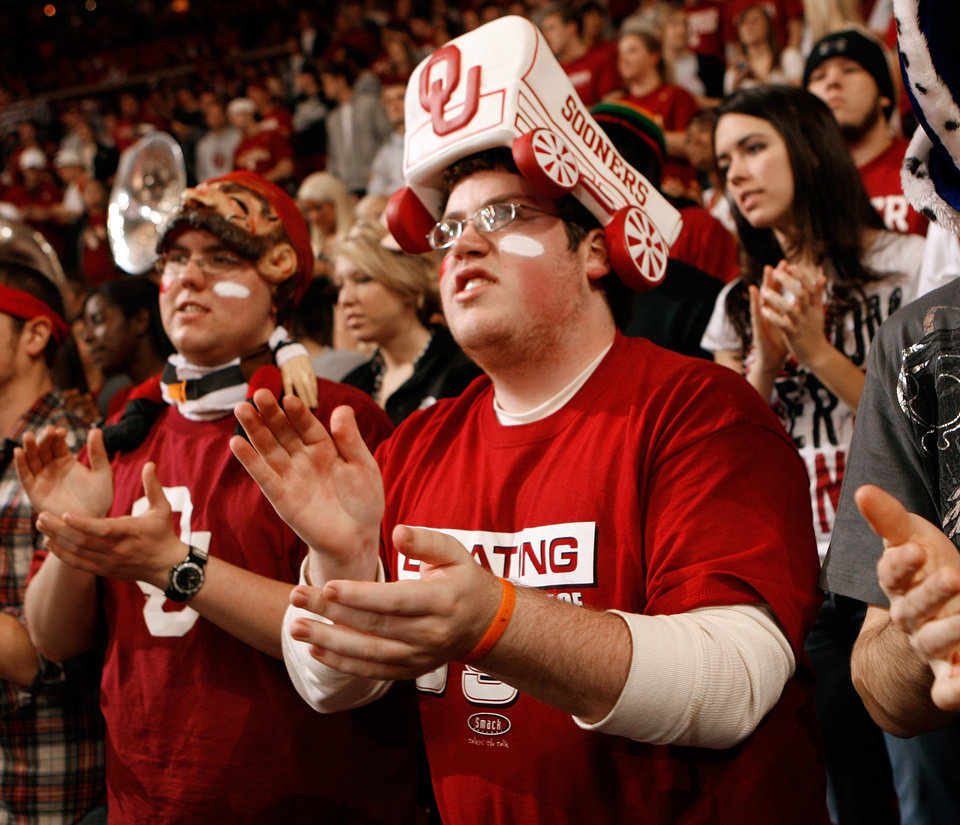 Photo - Matt Wormus, Olathe, Kansas freshman, claps during the first half of the college bedlam basketball game between The University of Oklahoma Sooners (OU) and Oklahoma State University University Cowboys (OSU) at the Lloyd Noble Center on Monday, Jan. 11, 2010, in Norman, Okla.