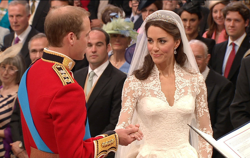 Photo - In this image taken from video, Britain's Prince William, left, takes the hand of his bride, Kate Middleton, as they stand at the altar at Westminster Abbey for the Royal Wedding in London on Friday, April, 29, 2011. (AP Photo/APTN) EDITORIAL USE ONLY NO ARCHIVE PHOTO TO BE USED SOLELY TO ILLUSTRATE NEWS REPORTING OR COMMENTARY ON THE FACTS OR EVENTS DEPICTED IN THIS IMAGE ORG XMIT: RWVM164