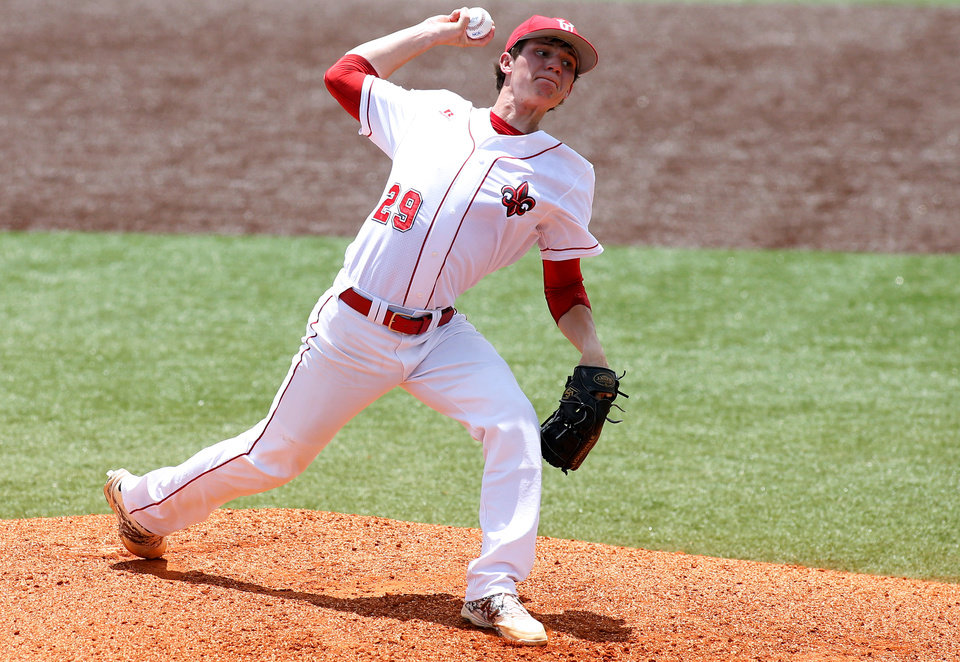 Photo - Louisiana-Lafayette pitcher Chris Charpentier (29) delivers in the first inning during an NCAA college baseball tournament regional game against Jackson State in Lafayette, La., Sunday, June 1, 2014. (AP Photo/Jonathan Bachman)