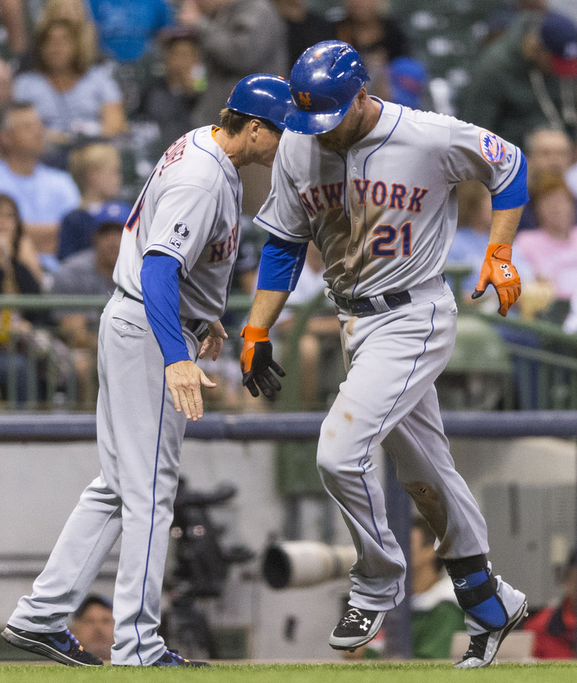Photo - New York Mets' Lucas Duda is greeted by third base coach Tim Teufel after hitting a solo home run off of Milwaukee Brewers' Matt Garza during the seventh inning of a baseball game Thursday, July 24, 2014, in Milwaukee. (AP Photo/Tom Lynn)