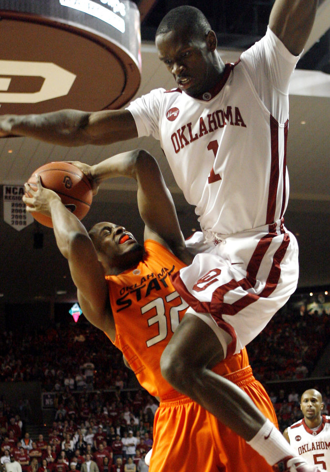 Photo - Oklahoma's Ryan Wright (1) goes over the top of OSU's Roger Franklin (32) for a foul during the first half of the college bedlam basketball game between The University of Oklahoma Sooners (OU) and Oklahoma State University University Cowboys (OSU) at the Lloyd Noble Center on Monday, Jan. 11, 2010, in Norman, Okla.