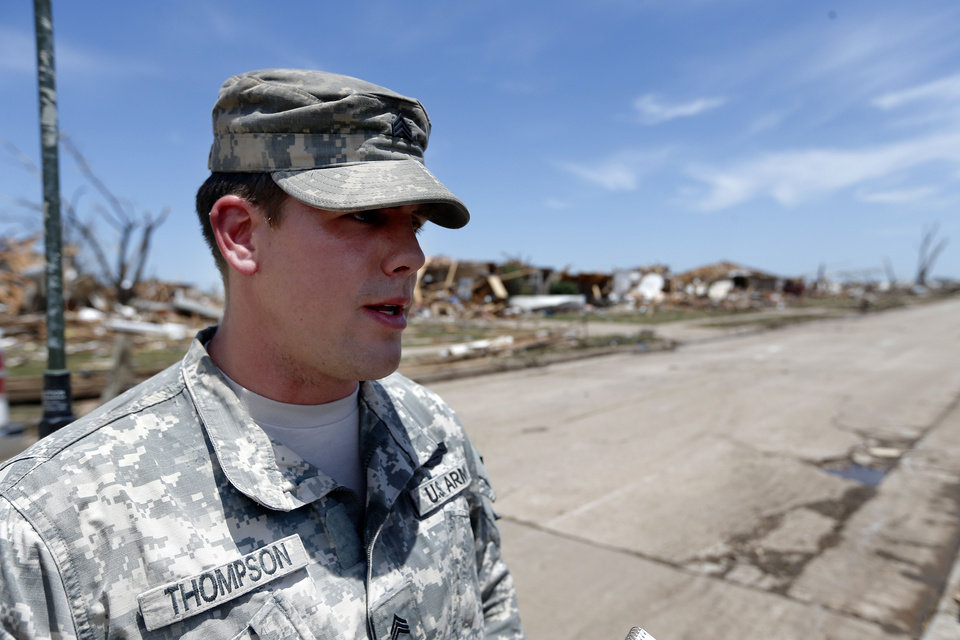 Photo - Sgt. Avery Thompson with the Oklahoma National Guard talks about securing checkpoints  Moore, Okla., Wednesday, May 22, 2013. Photo by Sarah Phipps, The Oklahoman