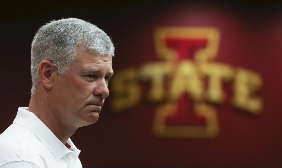 Photo - Iowa State football coach Paul Rhoads takes questions from members of the media at the Iowa State football media day on Sunday, Aug. 10, 2014, at Jack Trice Stadium in Ames, Iowa. (AP Photo/The Des Moines Register, Charlie Litchfield) MAGS OUT, TV OUT, NO SALES, MANDATORY CREDIT
