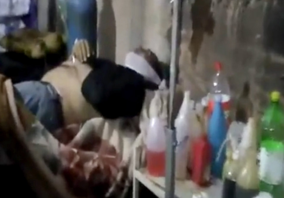 Photo - In this Wednesday, March 27, 2013 image taken from video obtained from the Shaam News Network, which has been authenticated based on its contents and other AP reporting, a wounded Syrian man receives treatment at a hospital in Daraa, Syria. (AP Photo/Shaam News Network via AP video)