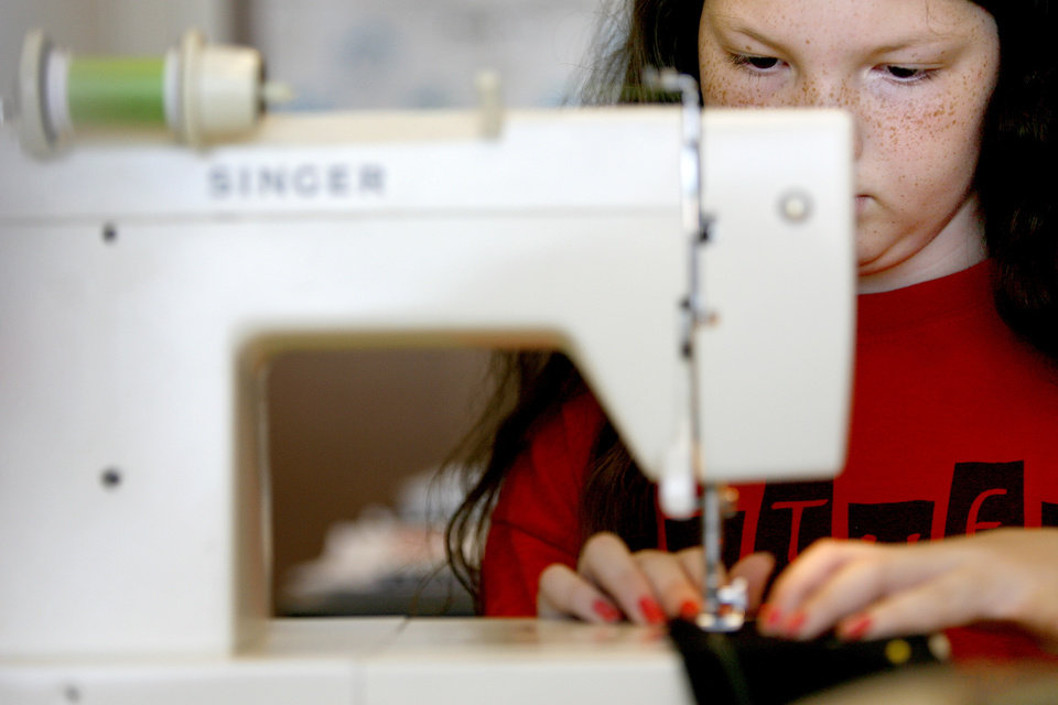 Macy Huston, 10, sews during a sewing class for kids at the Multi-Activity Center in Edmond, Okla., Tuesday, May 26, 2009. Photo by Bryan Terry, The Oklahoman
