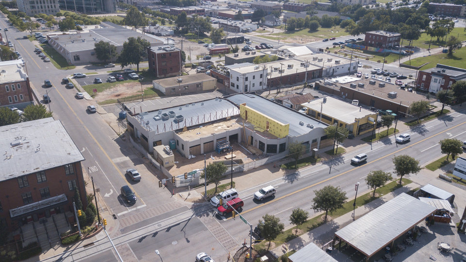 Photo -  Work has started on a rooftop dining area at the future home of The Collective as shown in this recent drone photo. [Photo by Dave Morris, The Oklahoman]