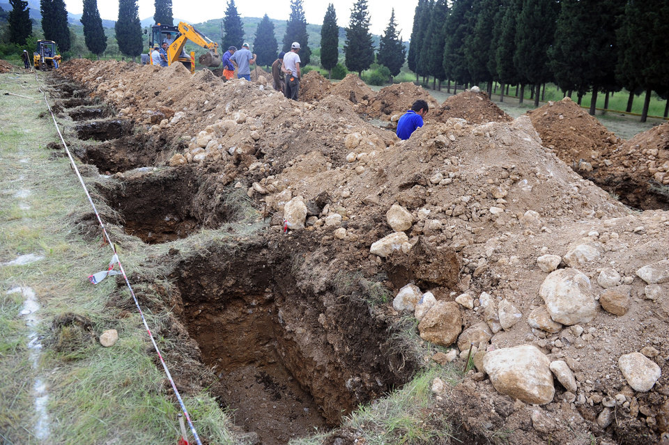 Photo - The rows of open graves for the mine accident victims in Soma, Turkey, Wednesday, May 14, 2014.  Rescuers raced against time to reach more than 200 miners trapped underground Wednesday after an explosion and fire at a local coal mine killed at least 245 workers, Energy Minister Taner Yildiz said Wednesday.(AP Photo/Emre Tazegul)