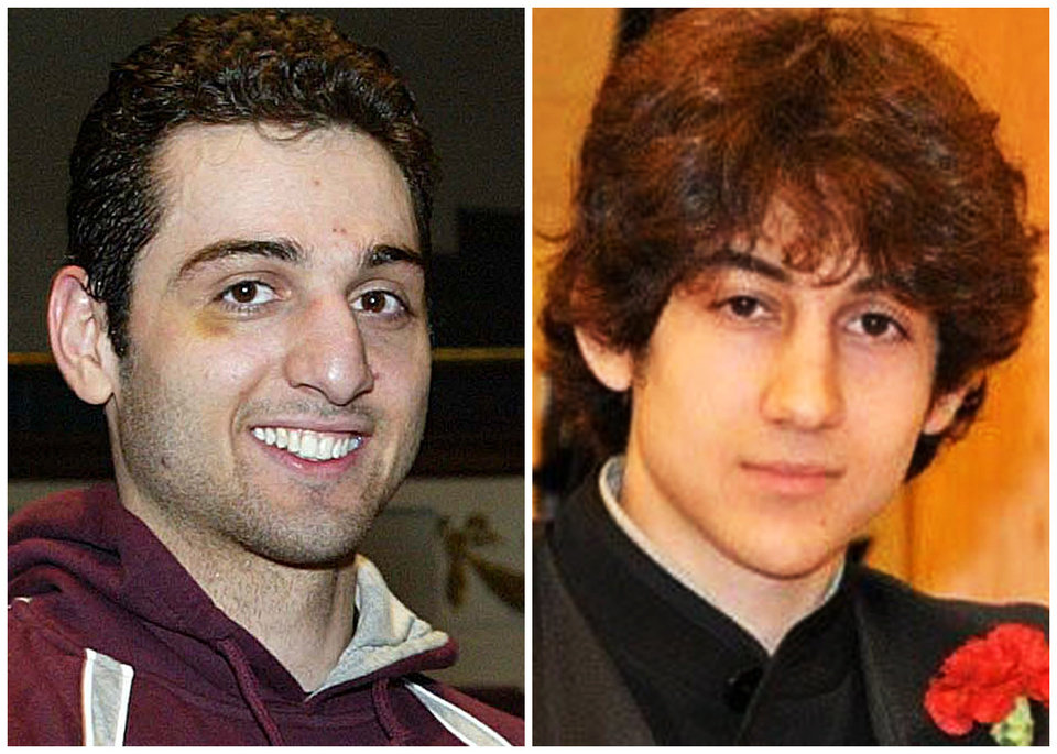 Photo - This combination of undated photos shows Tamerlan Tsarnaev, 26, left, and Dzhokhar Tsarnaev, 19. The FBI says the two brothers and suspects in the Boston Marathon bombing killed an MIT police officer, injured a transit officer in a firefight and threw explosive devices at police during a getaway attempt in a long night of violence that left Tamerlan dead and Dzhokhar still at large on Friday, April 19, 2013. The ethnic Chechen brothers lived in Dagestan, which borders the Chechnya region in southern Russia. They lived near Boston and had been in the U.S. for about a decade, one of their uncles reported said. (AP Photo/The Lowell Sun & Robin Young)