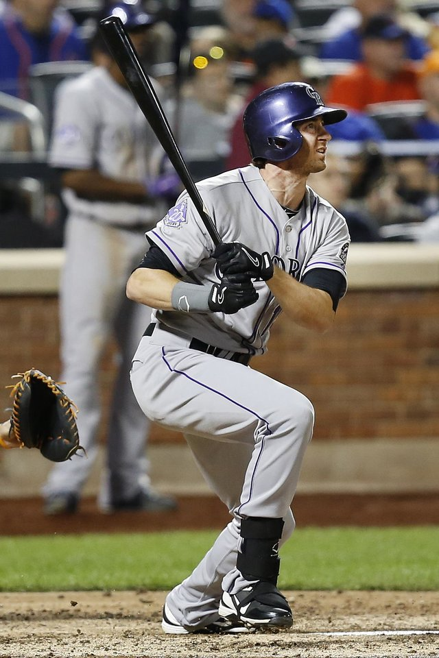 Photo - Colorado Rockies right fielder Charlie Blackmon watches his solo home run in the sixth inning of a baseball game against the New York Mets at Citi Field, Tuesday, Aug. 6, 2013, in New York. (AP Photo/John Minchillo)
