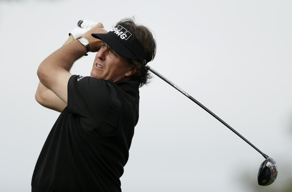 Photo - Phil Mickelson watches his tee shot on the second hole of the South Course during the second round of the Farmers Insurance Open golf tournament Friday, Jan. 24, 2014, in San Diego. (AP Photo/Gregory Bull)