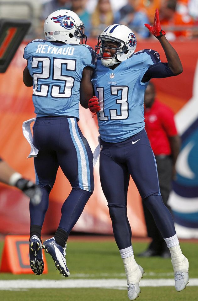 Photo -   Tennessee Titans wide receiver Kendall Wright (13) celebrates his 9-yard touchdown pass play with wide receiver Darius Reynaud (25) against the Miami Dolphins during the first half of an NFL football game on Sunday, Nov. 11, 2012, in Miami, Fla. (AP Photo/Wilfredo Lee)
