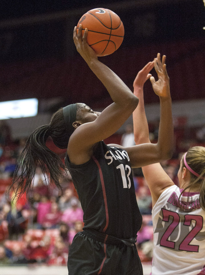 Stanford forward Chiney Ogwumike (13) scores on this shot over Washington State forward Sage Romberg (22) during the first half of an NCAA college basketball game Friday, Feb. 7, 2014, at Beasley Coliseum in Pullman, Wash. (AP Photo/Dean Hare)