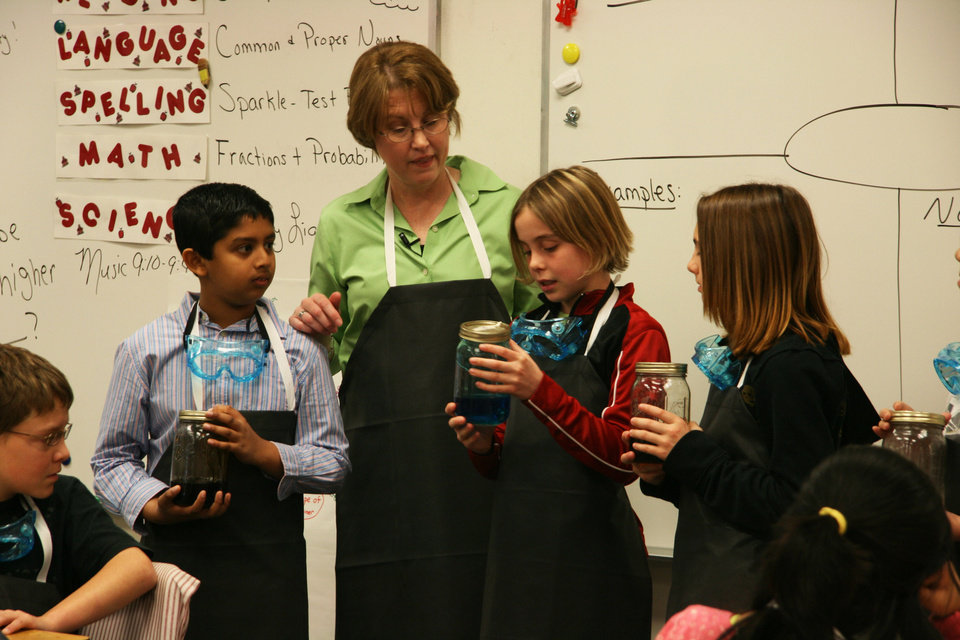 Photo - Fifth-grade teacher Jeri Doane works on an experiment developed by the Oklahoma Energy Resources Board wtih her students at Angie Debo Elementary in Edmond. Photo provided