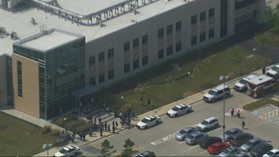 Photo - This frame grab provided by KTRK shows the scene above the Cy-Fair campus of Lone Star Community College in Cypress, Texas, where officials say about a dozen people have been wounded in a stabbing attack Tuesday, April 9, 2013. The Harris County Sheriff's department confirmed at least 11 people wounded and that authorities have one suspect in custody. (AP Photo/KTRK)