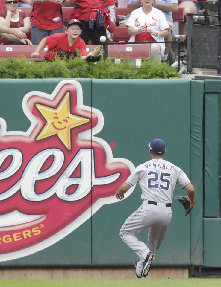 Photo - San Diego Padres right fielder Will Venable (25) watches as a fan catches a home run ball hit by St. Louis Cardinals' Matt Carpenter in the second inning of a baseball game, Sunday, Aug. 17, 2014, in St. Louis. (AP Photo/Tom Gannam)