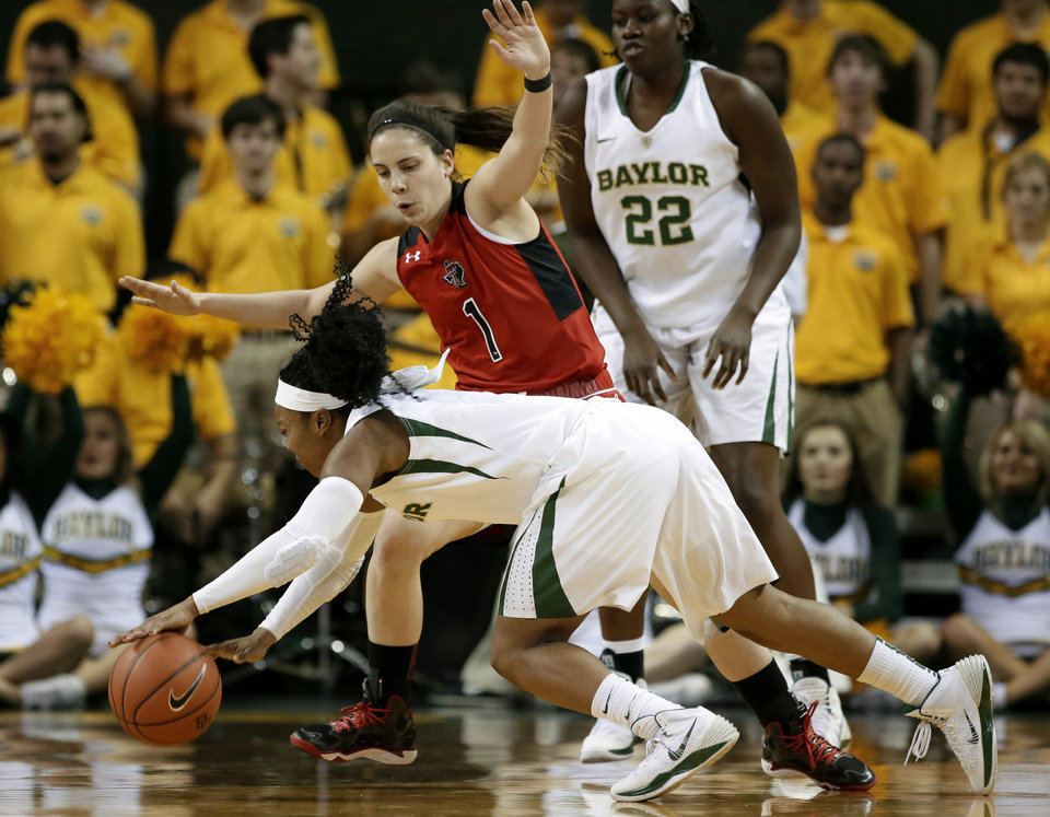 Photo - Baylor's Odyssey Sims (0) falls to the ground trying to get around Texas Tech's Marina Lizarazu (1) in the first half of an NCAA college basketball game, Wednesday, Jan. 29, 2014, in Waco, Texas. (AP Photo/Tony Gutierrez)