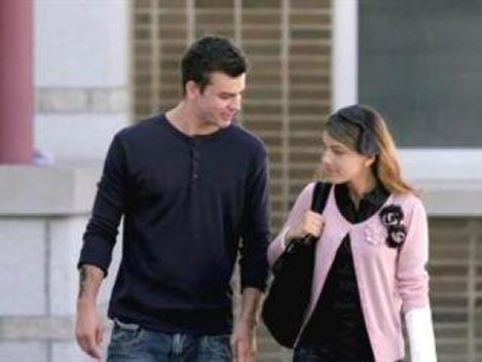 "Brendan King and Natalie, portrayed by Crawford Wilson and Kayla Compton, walk together in a scene from the feature film ""King's Faith."" Photo provided <strong></strong>"