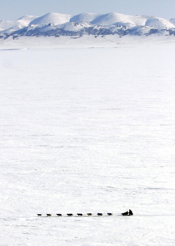 FILE - Canadian musher Sebastian Schnuelle drives his team across Norton Bay, March 16, 2009, near the Shaktoolik, Alaska checkpoint on the Iditarod Trail Sled Dog Race. (AP Photo/Al Grillo, File)