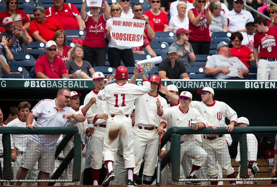 Photo - Indiana's Will Nolden (11) celebrates with teammates after scoring a run against Nebraska in the bottom of the second inning of an NCAA college baseball game for the Big Ten championship at TD Ameritrade Park in Omaha, Neb., Sunday, May 25, 2014. (AP Photo/The Omaha World-Herald/Rebecca S. Gratz)