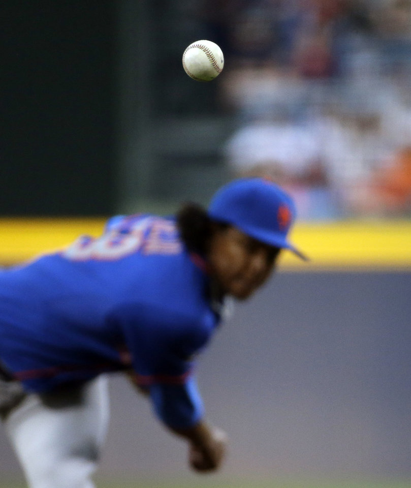 Photo - The ball is thrown by New York Mets starting pitcher Jenrry Mejia in the first inning of a baseball game against the Atlanta Braves, Thursday, April 10, 2014, in Atlanta. (AP Photo/David Goldman)