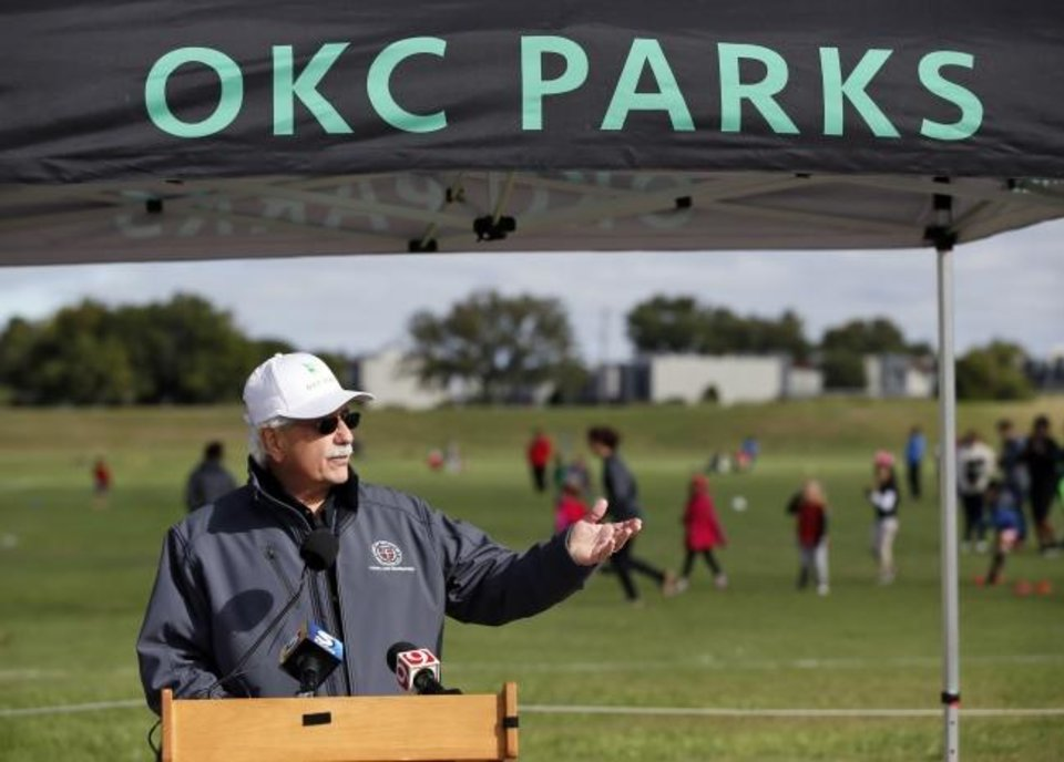 Photo -  Doug Kupper, Oklahoma City Parks and Recreation director, speaks during a ceremony to celebrate the revitalization of Lightning Creek Park, 801 SW 81 St., in 2018. A public-private partnership between the McLaughlin Family Foundation, Progress OKC and the Oklahoma City Parks and Recreation Department turned the park into high-quality soccer practice fields.  [Nate Billings/The Oklahoman Archives]