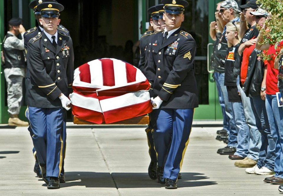OKLAHOMA ARMY NATIONAL GUARD / SOLDIER / MILITARY / DEATH / OKLAHOMAN / AFGHANISTAN / SOLDIER:  Honor guard members carry the casket during the funeral for 1st Lt. Damon Leehan at Henderson Hills Baptist Church on Thursday, August 25, 2011, in Edmond, Okla. Leehan was killed in Afghanistan Aug. 14, when a military vehicle he was riding in struck an IED. Photo by Chris Landsberger, The Oklahoman ORG XMIT: KOD