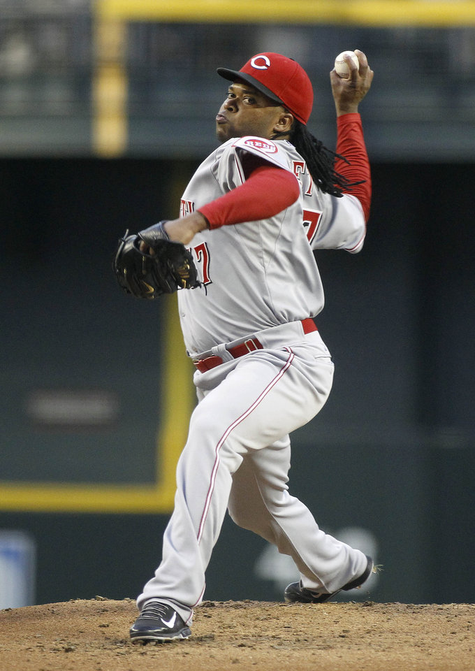 Photo - Cincinnati Reds' Johnny Cueto delivers a pitch against the Arizona Diamondbacks during the first inning of a baseball game on Saturday, May 31, 2014, in Phoenix. (AP Photo/Ralph Freso)