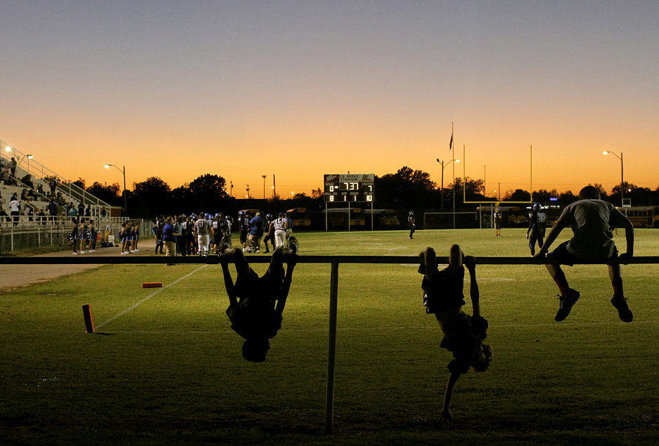 Students from Deer Creek play on a railing on the east end of C.B. Speegle Stadium during the high school football game between Deer Creek and Southeast in south Oklahoma City on Thursday, September 29, 2011. Photo by John Clanton, The Oklahoman