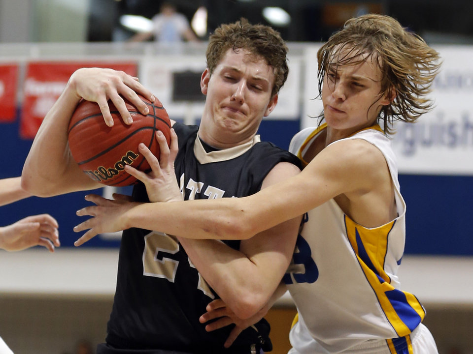 Chouteau\'s Jordon Shive defends against Latta\'s Jake Collins during the 2A boys high school basketball game in the semifinals of the state tournament between Latta and Chouteau at Oklahoma City University in Oklahoma City, Friday, March 8, 2013. Photo by Sarah Phipps, The Oklahoman