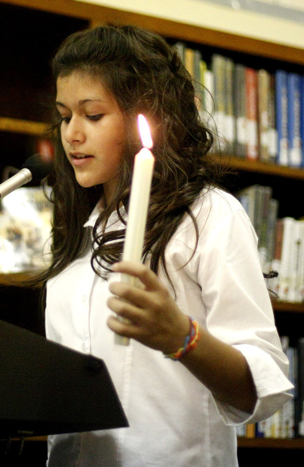 Natalie Perez speaks during the Girl Scout Troop 4089 Investiture Ceremony, Friday, Jan.  21, 2011, at Taft Middle School in Oklahoma City. Photo by Sarah Phipps, The Oklahoman