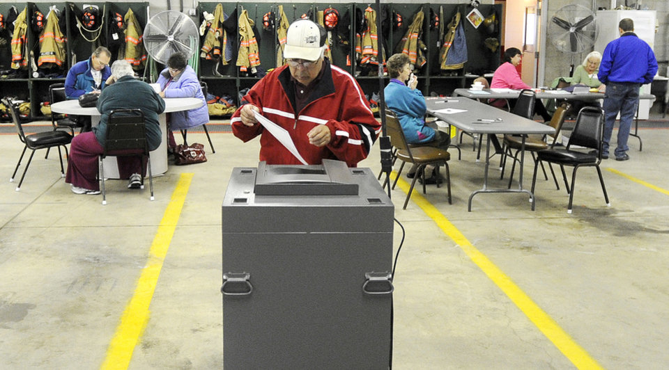 Martin Arellano of Goodview, Minn., casts his vote Tuesday, Nov. 6, 2012, at the Goodview Fire Station. After a grinding presidential campaign, Americans are heading into polling places across the country. (AP Photo/Winona Daily News, Andrew Link)