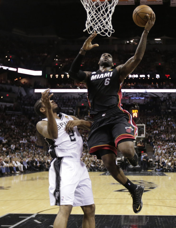 Photo - Miami Heat's LeBron James (6) shoots as San Antonio Spurs' Kawhi Leonard (2) defends during the first half at Game 4 of the NBA Finals basketball series, Thursday, June 13, 2013, in San Antonio. (AP Photo/Eric Gay, Pool)